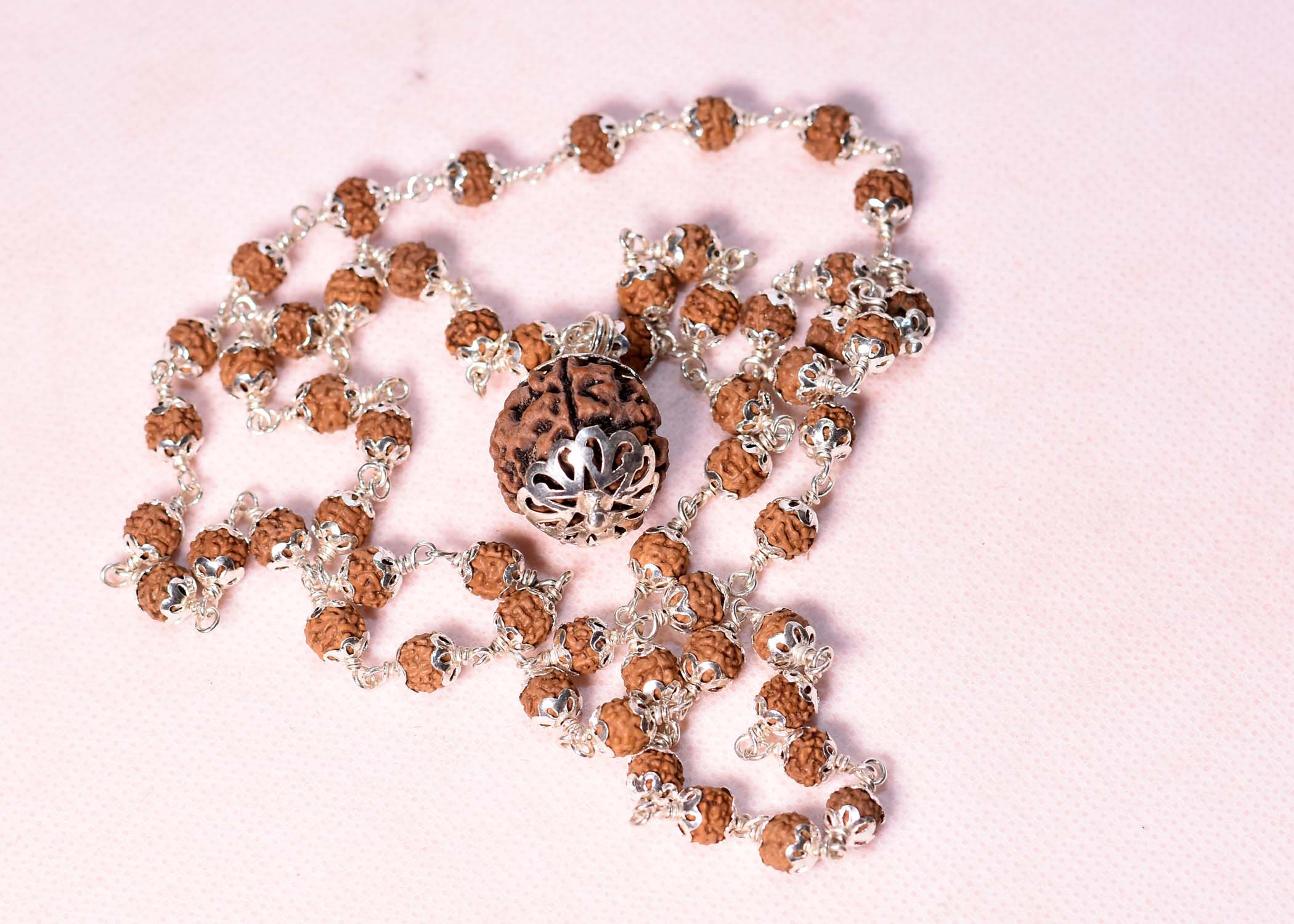 silver covered rudraksha with 6 mukhi pendant